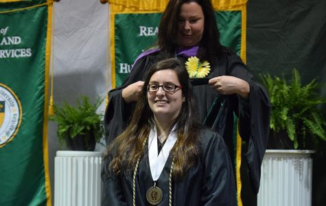 Seniors receive hoods at Hooding and Honors Ceremony
