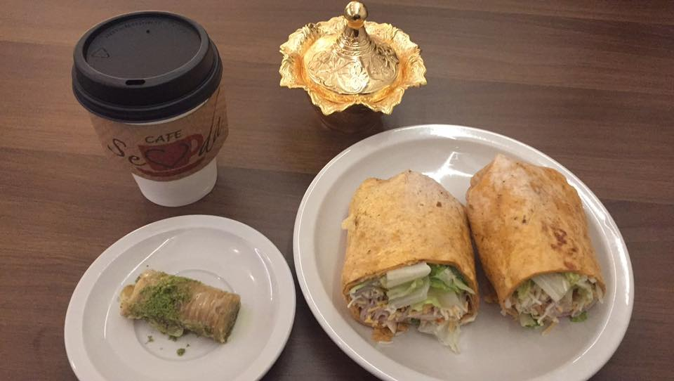 A chai latte, Pistachio roll baklava, and the Turkey wrap.