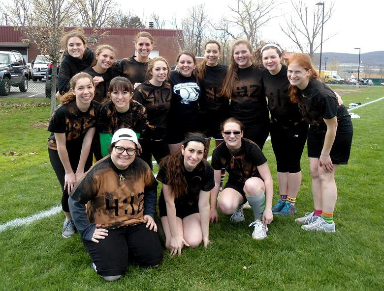 Members of Women's Group pose on one of Marywood's fields after a group kickball activity.