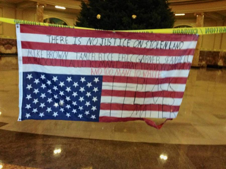 The U.S. Flag hangs upside down and written upon in the photo that sparked the controversy.
