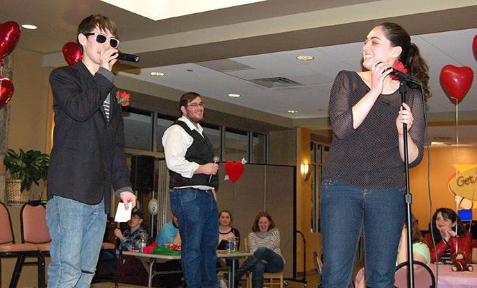 Emcees Frank Winger and Ryan Kozich ask candidate Dana Boeh questions at the Date Auction held on Feb. 13.