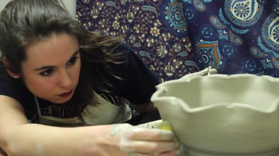 Sophomore+ceramic+and+art+administration+major+Emma+Pilon+crafts+a+bowl+in+preparation+for+the+bowl.+
