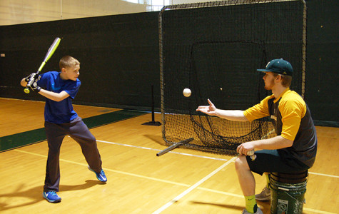 "Baseball team hosts ""Pitches In"" clinic"