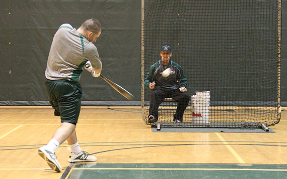 Due to the inclement weather the baseball team has had to practice in the gym.  The practices consist of batting drills and fielding drills.