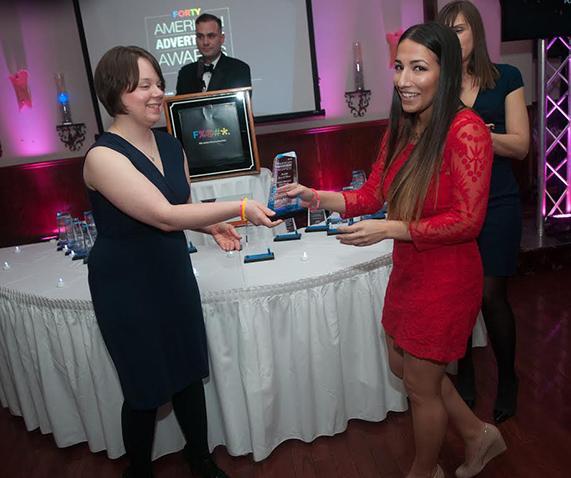 AAF Board Member and Marywood Alum Desiree Zielinski presents an award  to Nailea Meneses