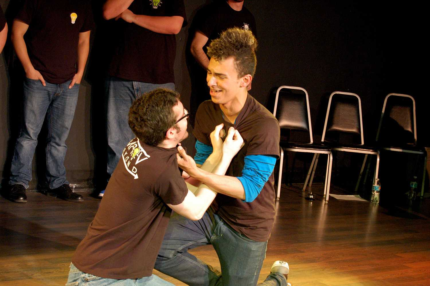 Paul Capoccia and Terry Thompson perform in Improv Beyond's Spring Show.