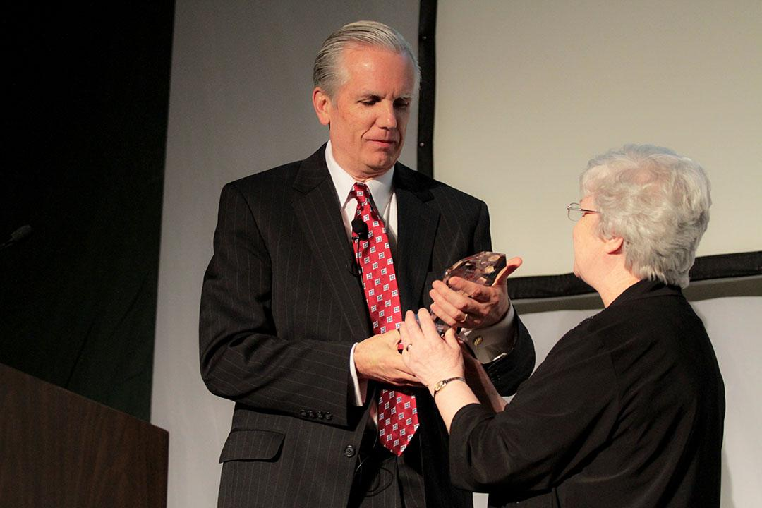 Sister Anne presents Jack Tighe with the Lead On award at last year's Community Leadership Celebration.