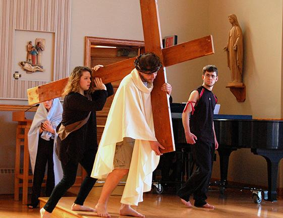 Miranda Micciche, Josh Moore, and Chris Wall perform in the Passion Play.