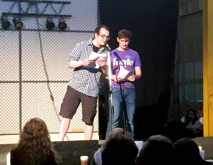 Mitchell Winters and Aidan Cronin reading poetry.