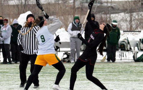 Tiffany Brznek facing an opponent during a home game against Arcadia University in 16-7 loss.