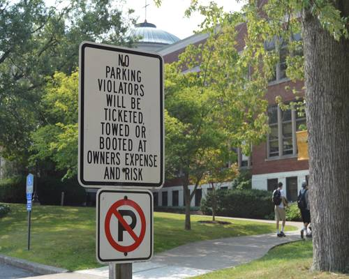 New signs posted in each designated lot for the 2015-16 academic year.