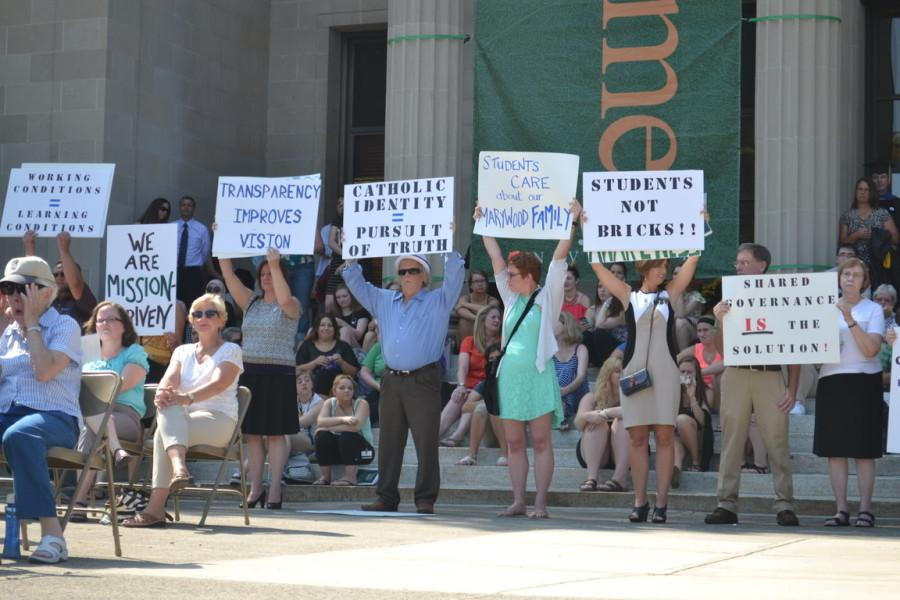 During the dedication of the Learning Commons, several members of faculty, as well as students, staged a silent protest on the steps of Liberal Arts Center.