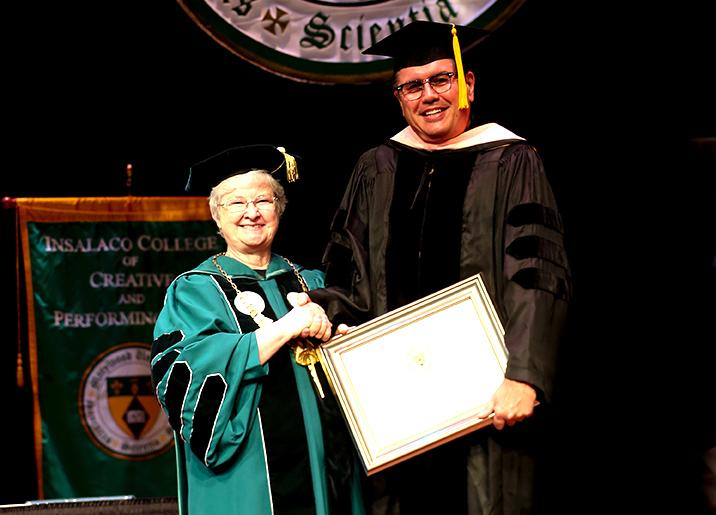 Sr.+Anne+poses+with+Dr.+F.+David+Romines+as+he+receives+his+faculty+award+at+the+2014+Convocation.+