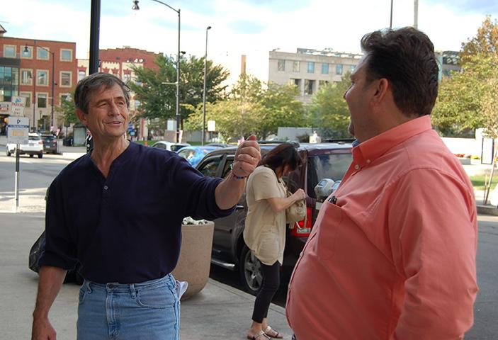 Admiral Joe Sestak talks to Lackawanna County Democratic Party Chairman Chris Patrick outside of the Northern Lights Café.