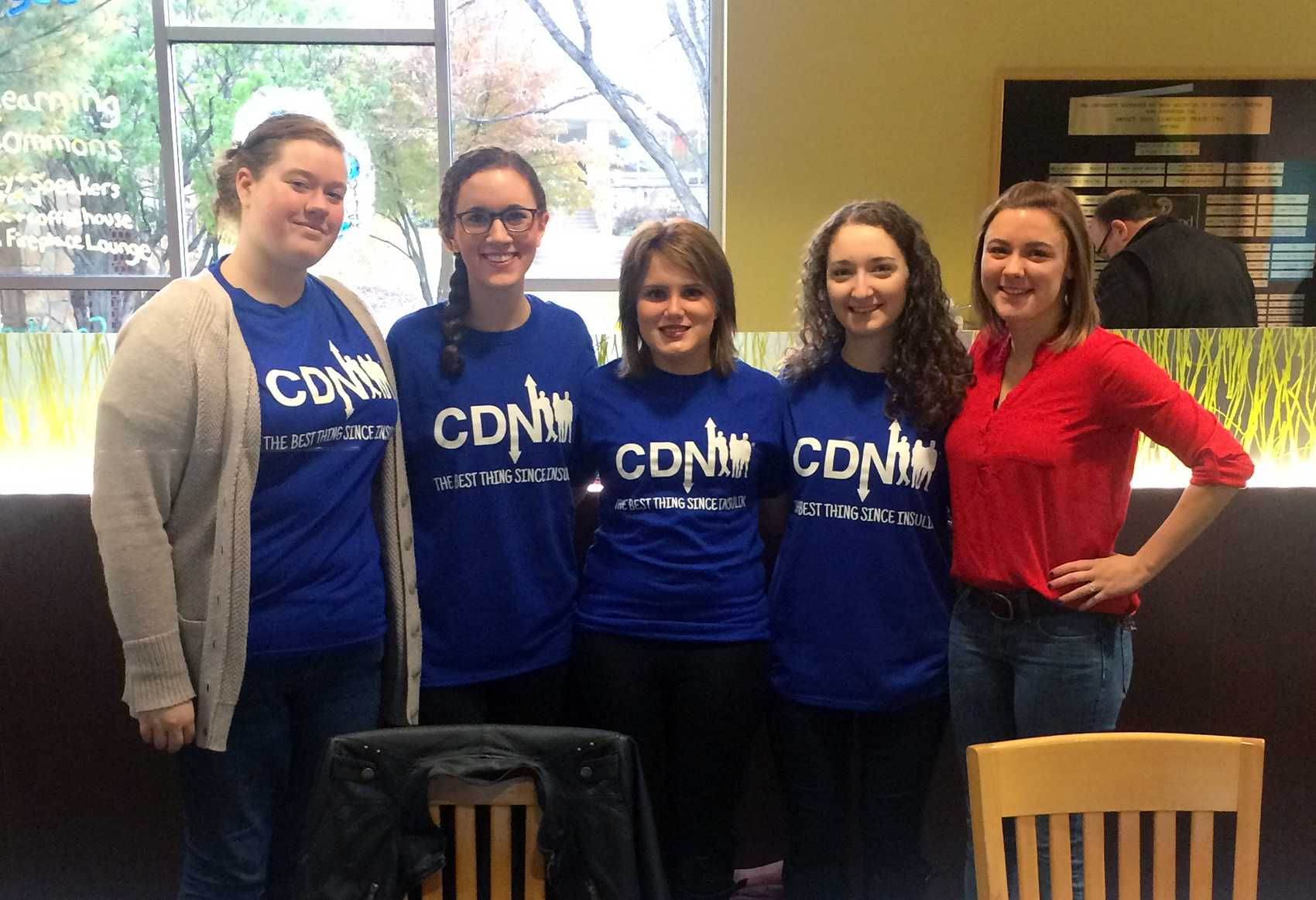 Members of the Marywood chapter of the College Diabetes Network stand by their club's table at the Oct. 24 Open House.
