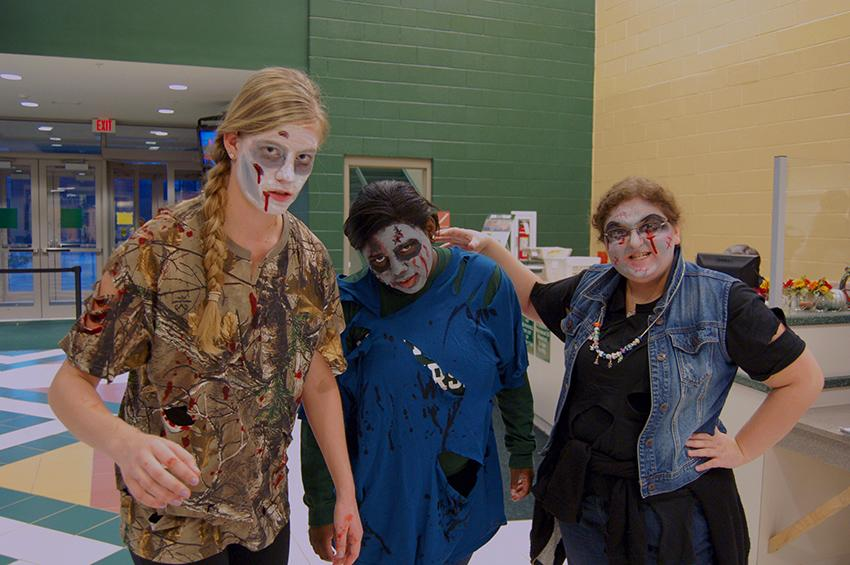 Students Janet Herington, Nadine Burton, and Amanda Marchese pose in their zombie makeup before SAC's Zombies vs. Humans event.