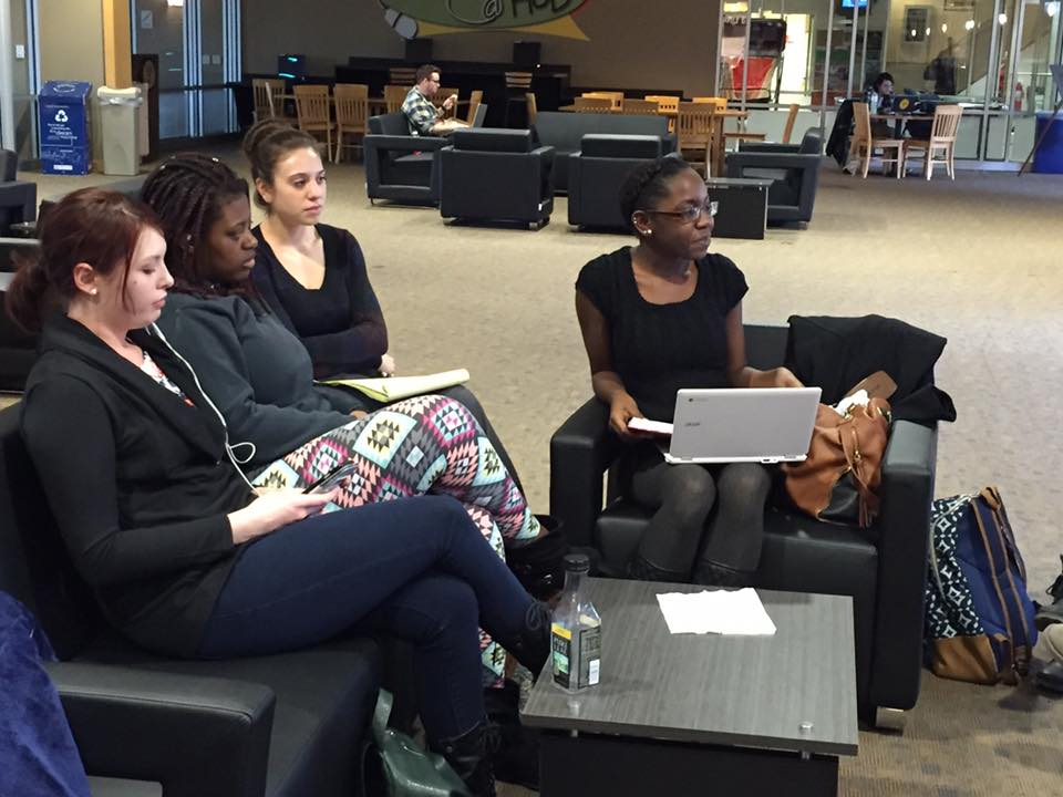 Jovanna Laurencin, far right, leads the Colleges Against Cancer club's first meeting in the Fireplace Lounge.