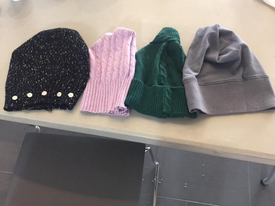 Members+of+PRSSA+made+hats+out+of+old+sweaters+to+donate+to+Friends+of+the+Poor.
