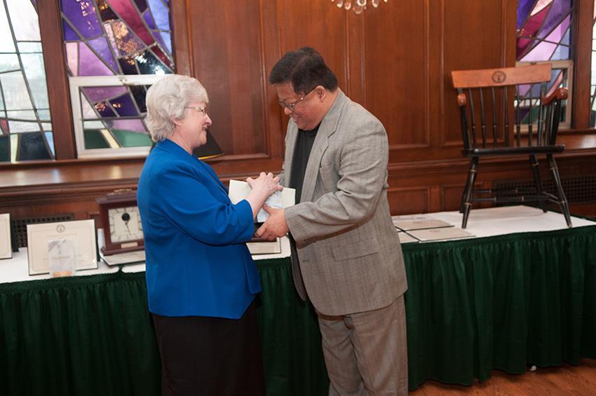 Sr+Anne+Munley+presents+Dr.+Uldarico+Rex+Dumdum+Jr.+with+his+award.+Photo+courtesy+of+Michael+Straub.