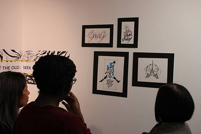 Students+look+at+the+work+on+display+at+the+%22Genesis%3A+Art+Through+The+Ages%22+exhibit.