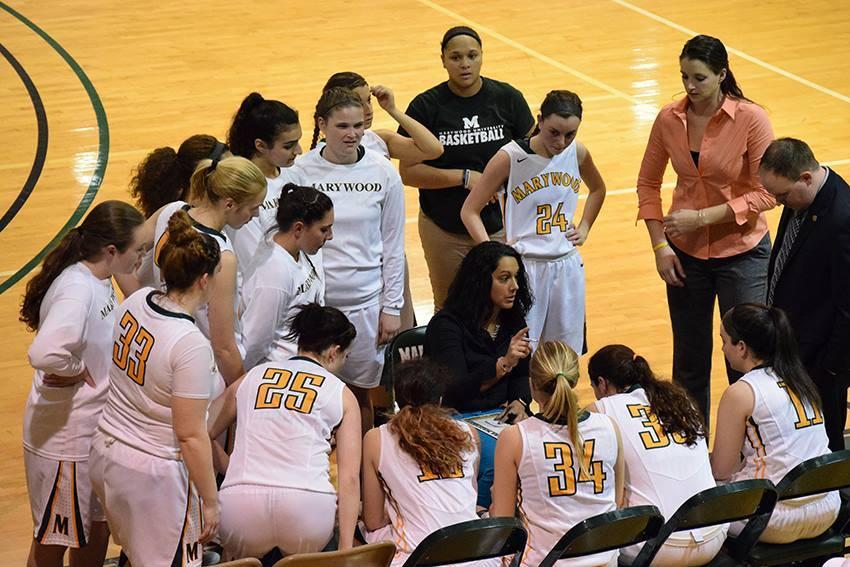 Tara Macciocco coaches her team during the CSAC semifinal playoff game against Neumann University.