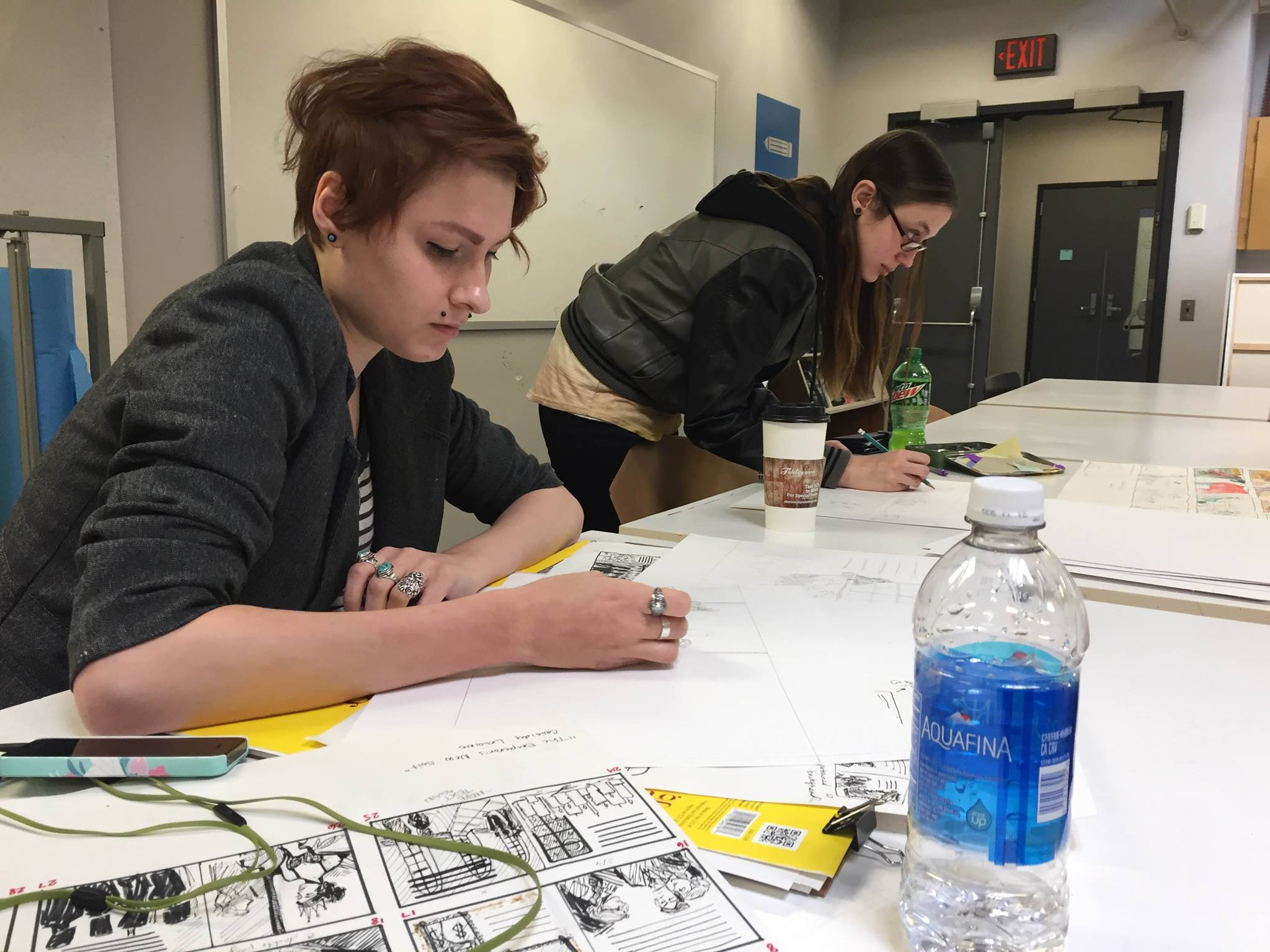 Senior illustration majors Cassidy Lesione and Deanna Szabo work on their projects in the Insalaco Center for Studio Arts.
