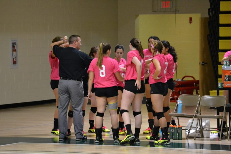 The+volleyball+team+gets+set+for+its+Dig+Pink+tri-match.