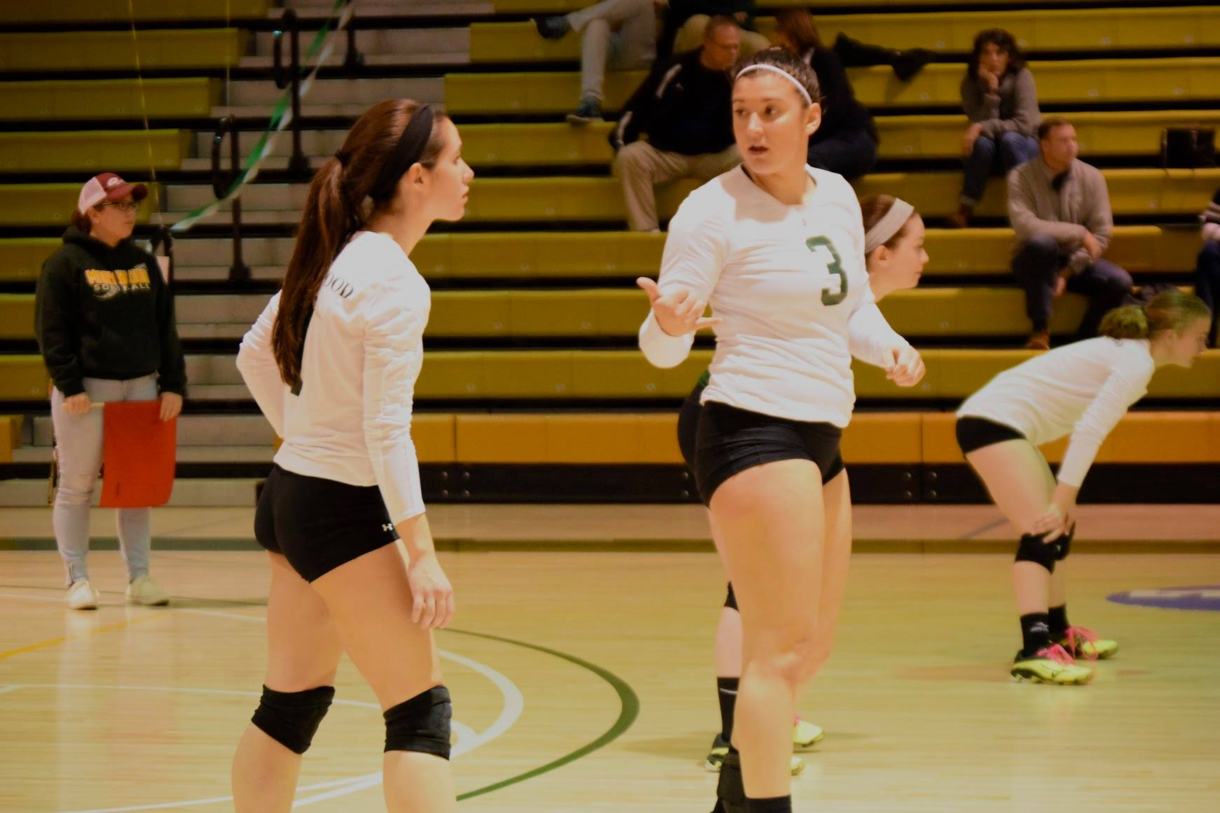 Sophomore Mallorie Deschaine talking strategy during the match
