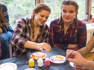 Freshmen nursing majors Elizabeth Vlicni and Cassidy Phillips participated in the Fall Festival activities.