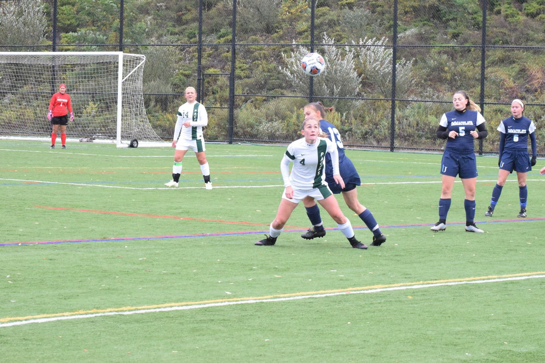 Sophomore Julie Youngman plays in a conference game with the Mighty Macs