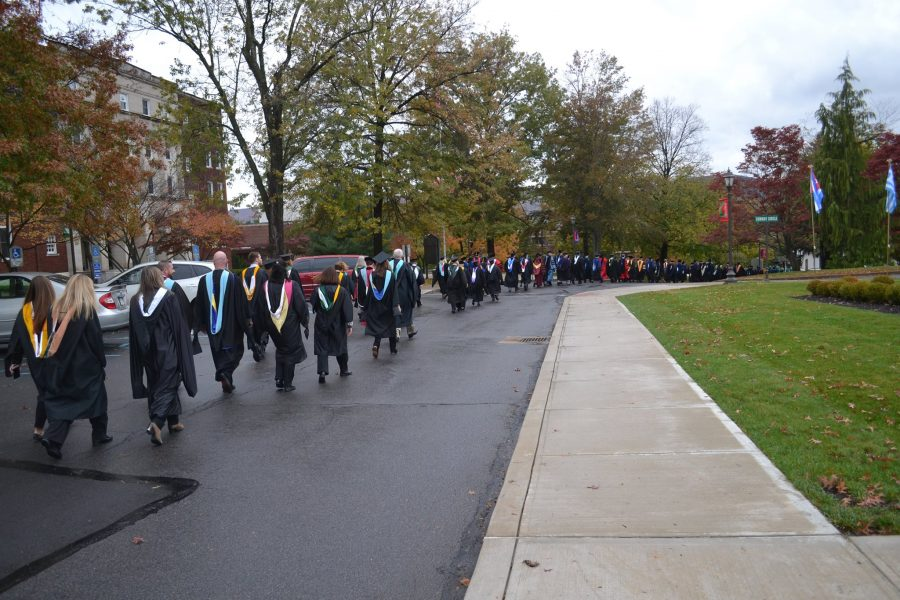Faculty+and+staff+walk+during+the+Academic+Procession.