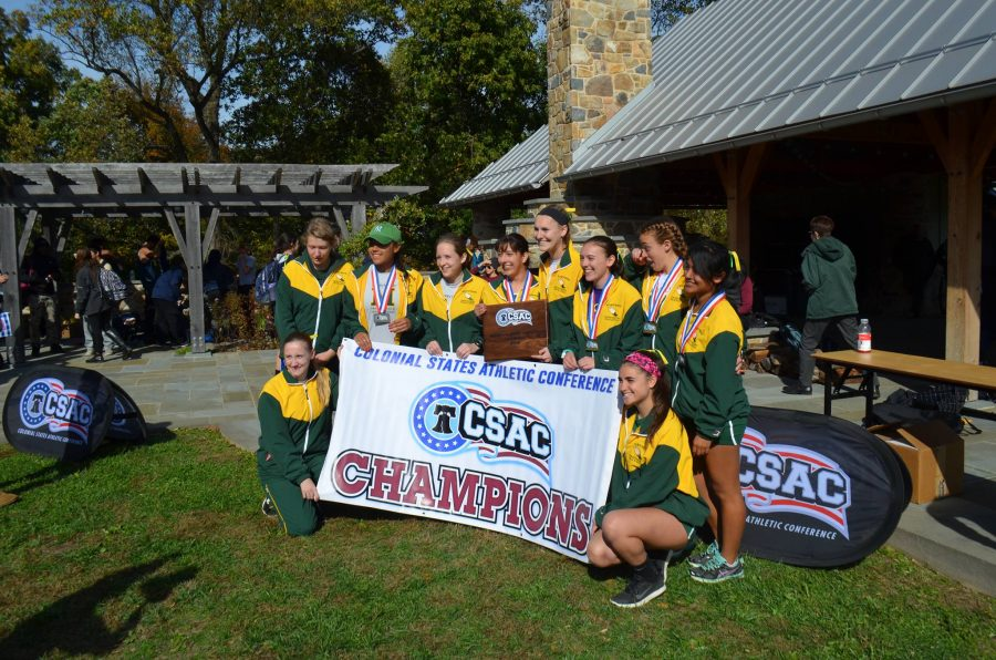 Women%27s+cross+country+team+celebrates+its+sixth+conference+championship+in+seven+years.+Courtesy+of+Marywood+Athletics