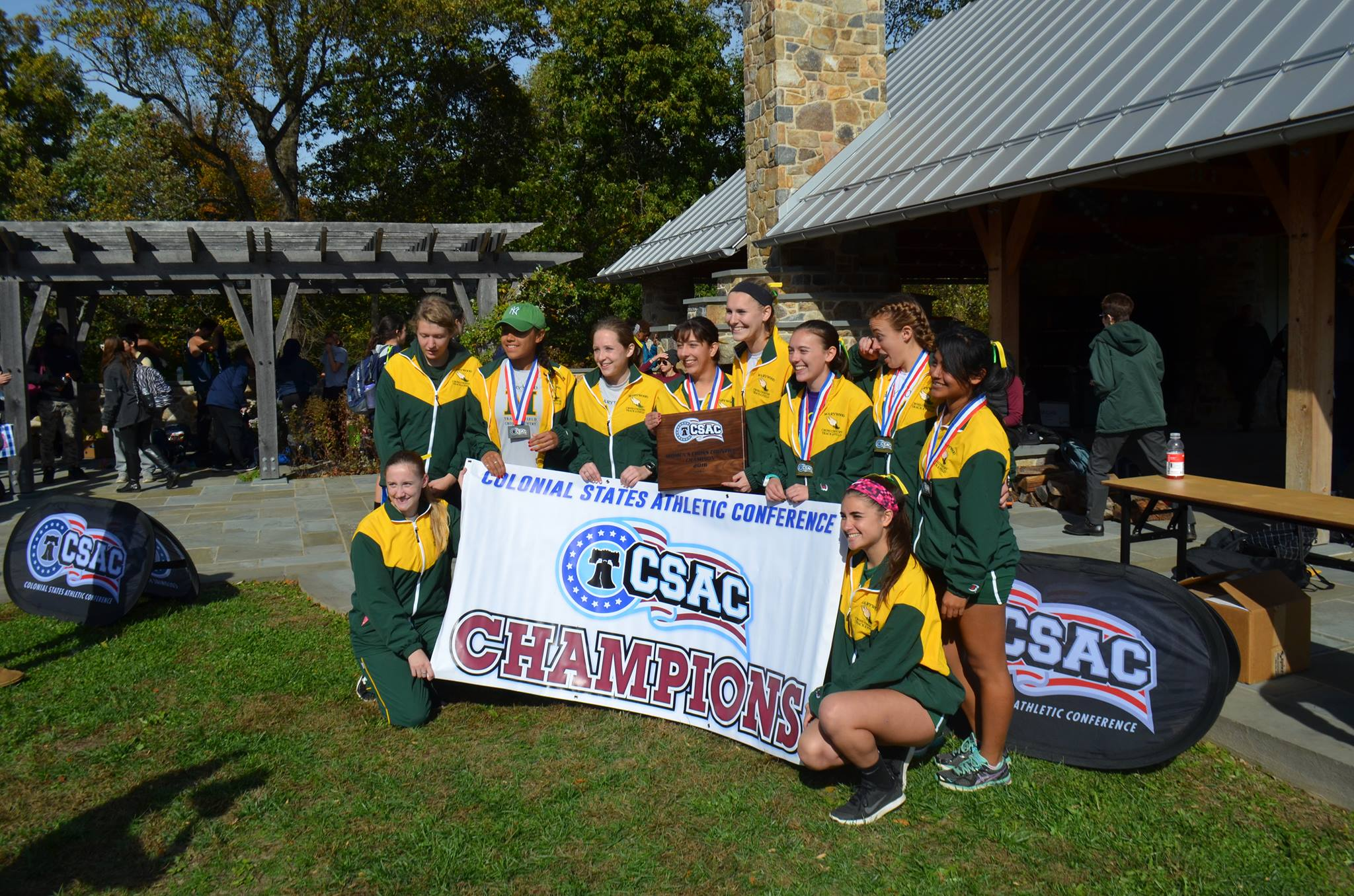 Women's cross country team celebrates its sixth conference championship in seven years. Courtesy of Marywood Athletics