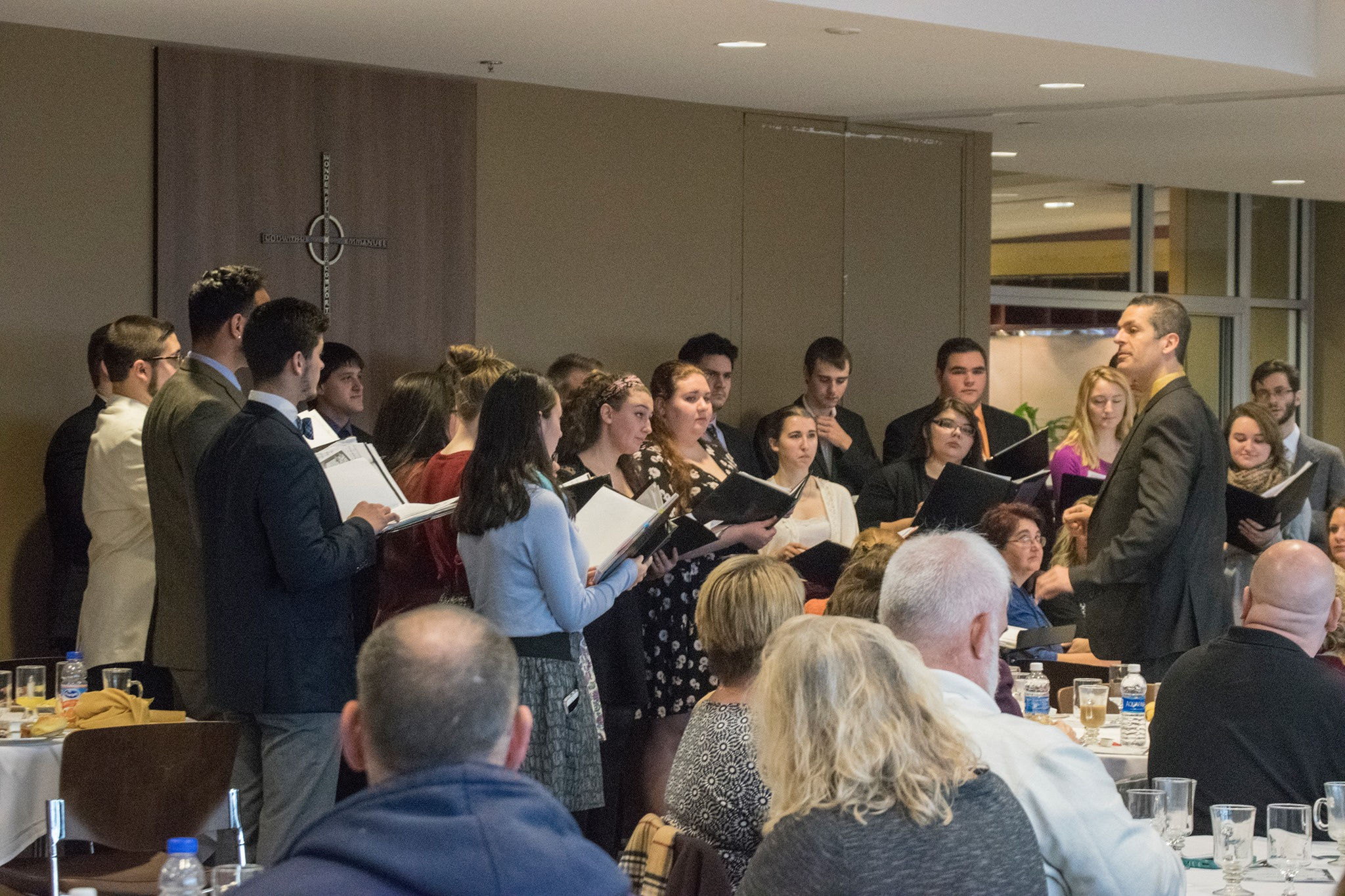 The Marywood Chamber Singers performed a short collection of songs to the people present at the breakfast.