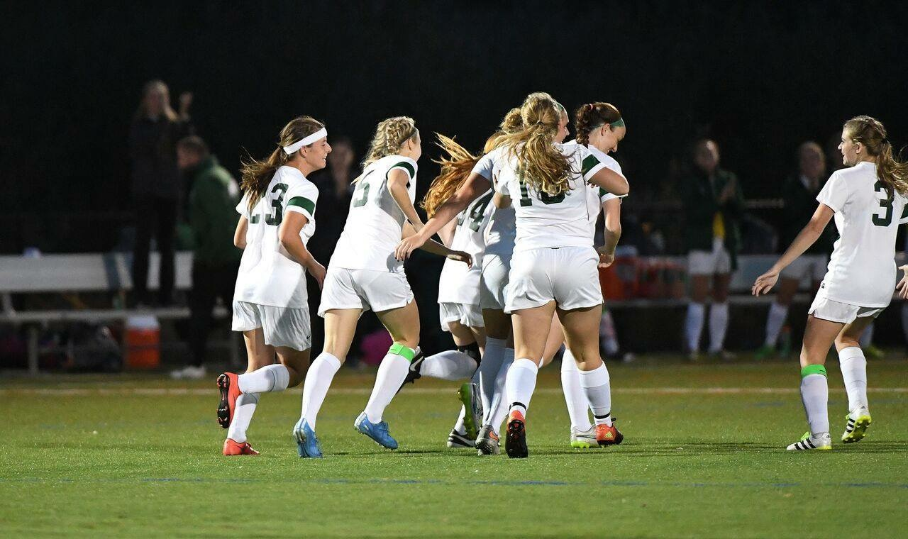 Women's soccer team celebrates goal in semifinal game. Photo courtesy of Marywood Athletics