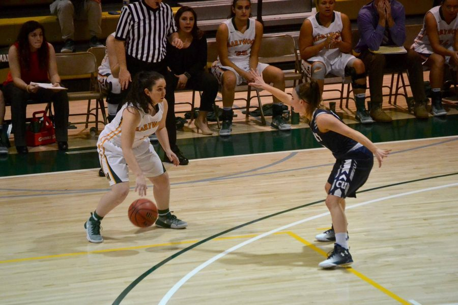 Marywood junior guard Lisa Steakin looks for an open shot in a 63-66 home opener loss to Centenary University.
