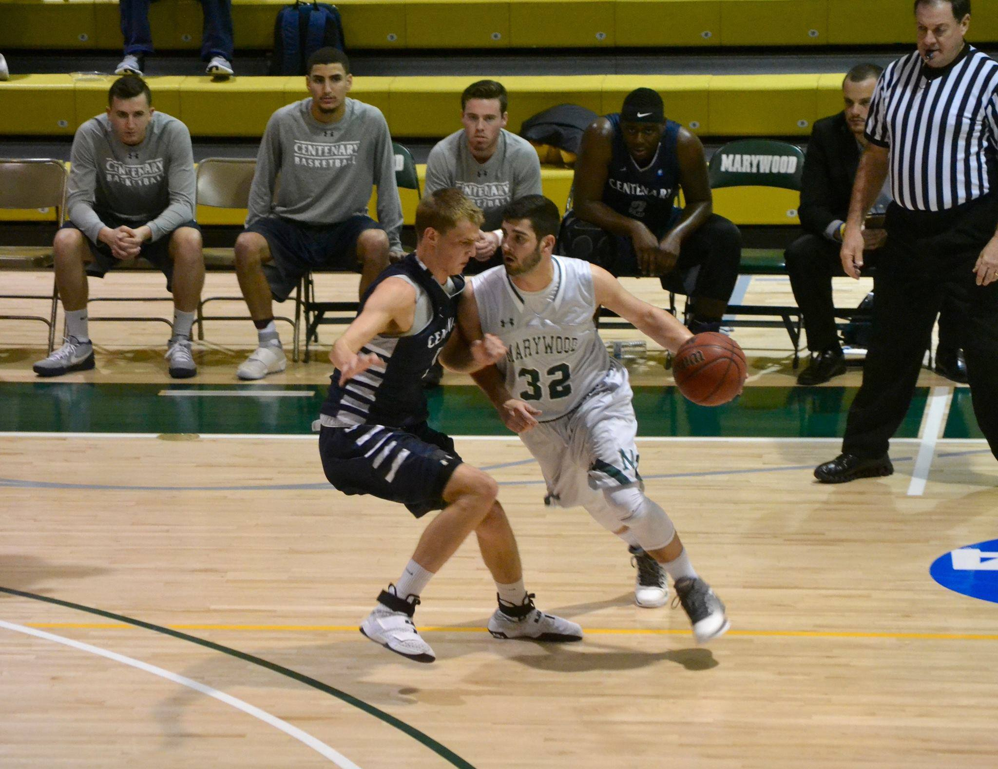 Marywood junior guard James Curley drives on a Centenary defender in a 63-77 home opener loss.