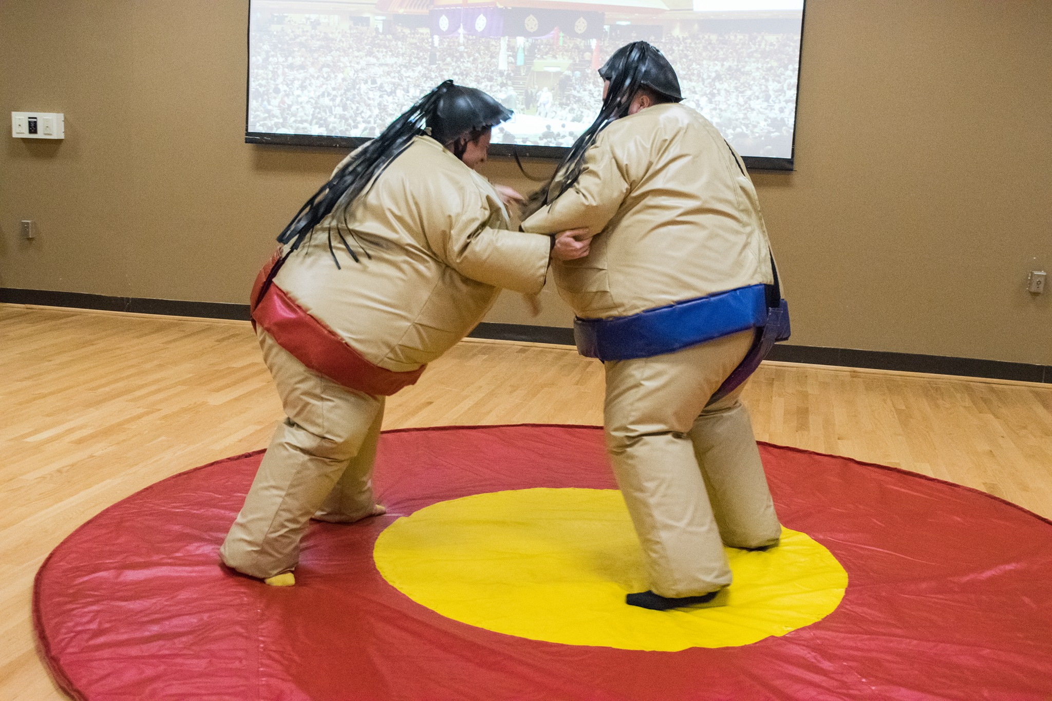 Tim Hackenberg, a third year architecture major, and Jarek Diehl, a third year interior architecture major, face off in a sumo wrestling match.
