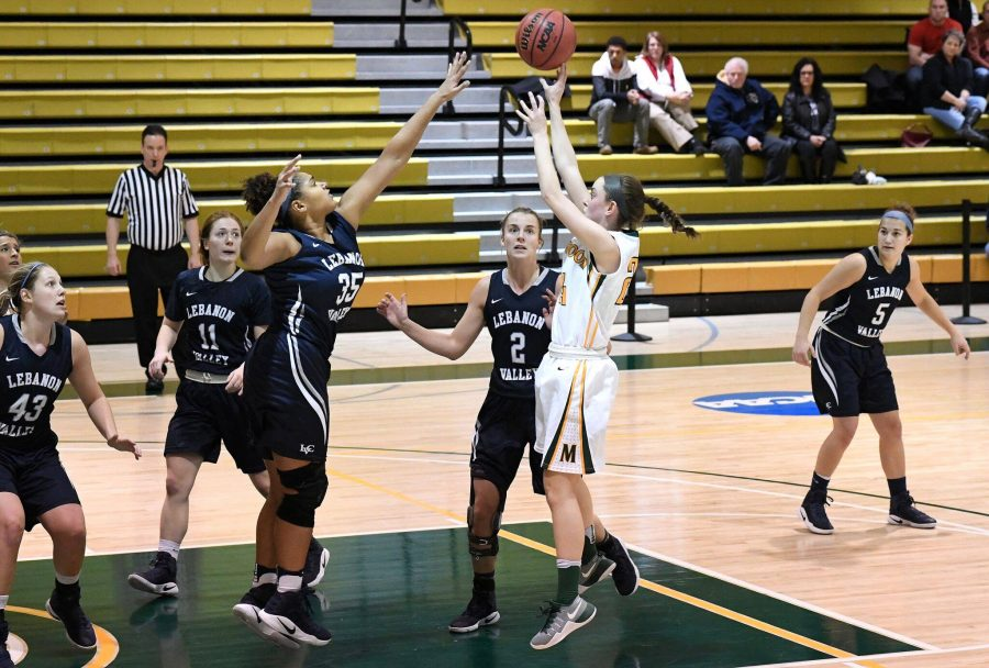 Photo courtesy of Marywood Athletics. Caption: Junior guard Catie Nealon attempts a jump shot over Lebanon Valley's Jasmine Copeland.