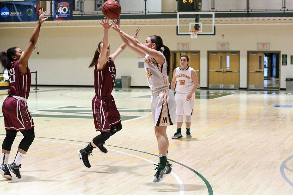 Junior guard Catie Nealon shoots jump shot over a Carin defender in blowout victory. Photo courtesy of Marywood Athletics.