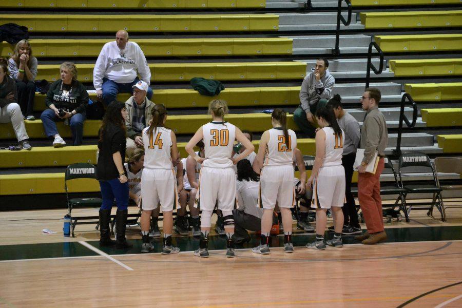 Women%27s+basketball+head+coach+Tara+Macciocco+talks+to+her+team+during+a+timeout.