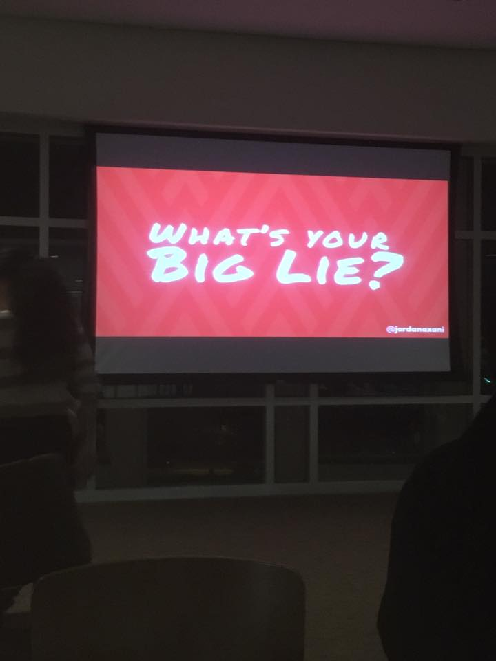"""Attendees texted in their biggest secrets to a phone number provided by """"What's Your Big Lie?"""" and shown on a screen for all attendees to read."""