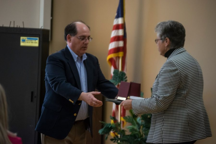 Frank Falcone, an institutional data specialist, accepts his award for 25 years at Marywood.