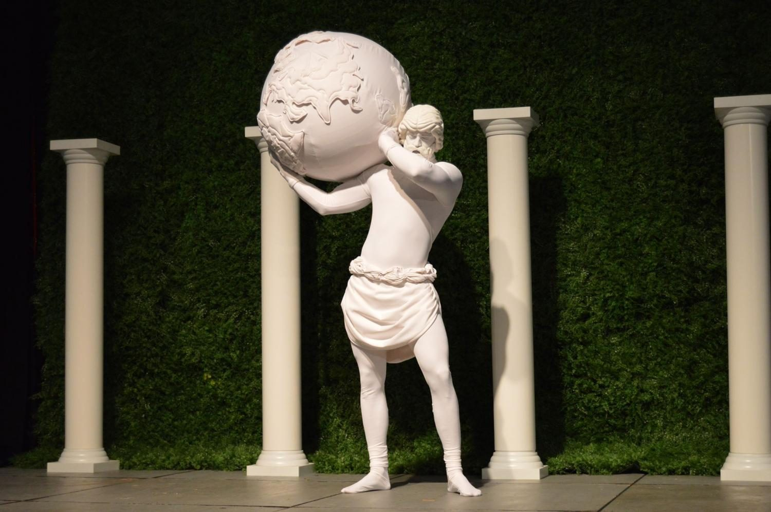 "A living sculpture of Atlas held up a globe to contribute to the ""Windows to the World"" theme."