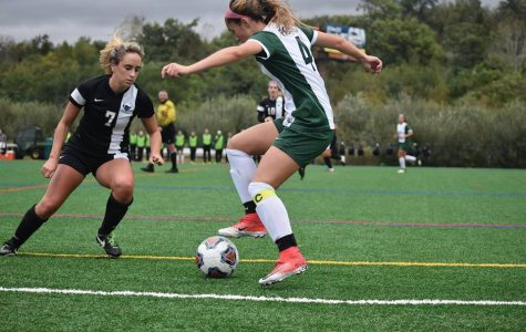 Junior midfielder/forward Julie Youngman attempts to navigate the Cavalier defense.