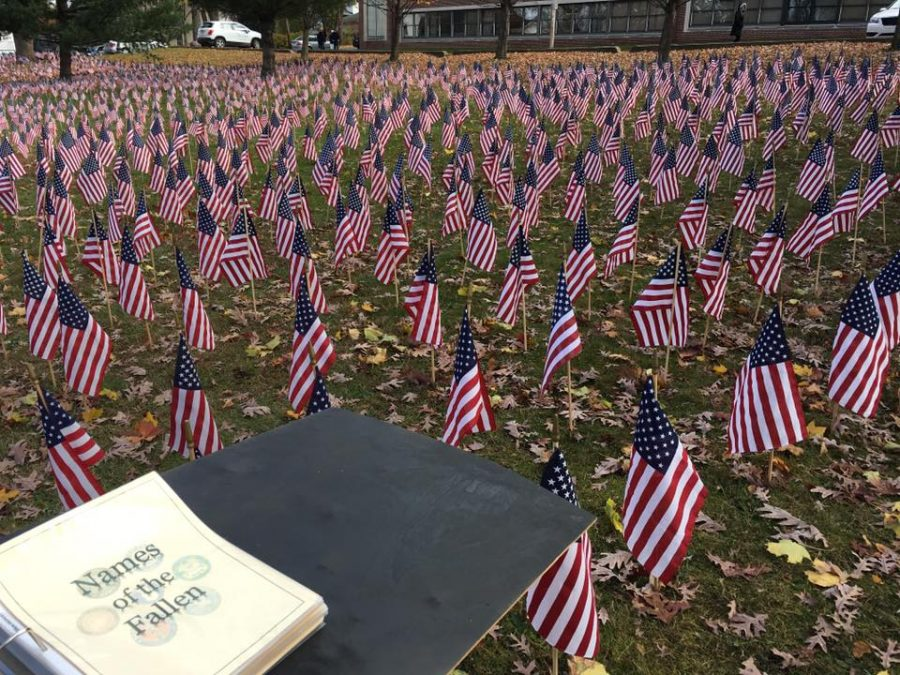 Flags+fly+next+to+a+binder+with+the+names+of+those+who+served.+