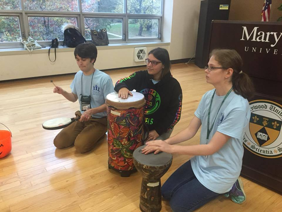 SOAR students enjoy drums via Marywood's Music Therapy Club. Facebook photo used with permission from the Marywood SOAR Program.