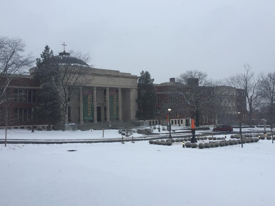 Snow falls outside the Liberal Arts Center the day before classes start for the spring 2018 semester.