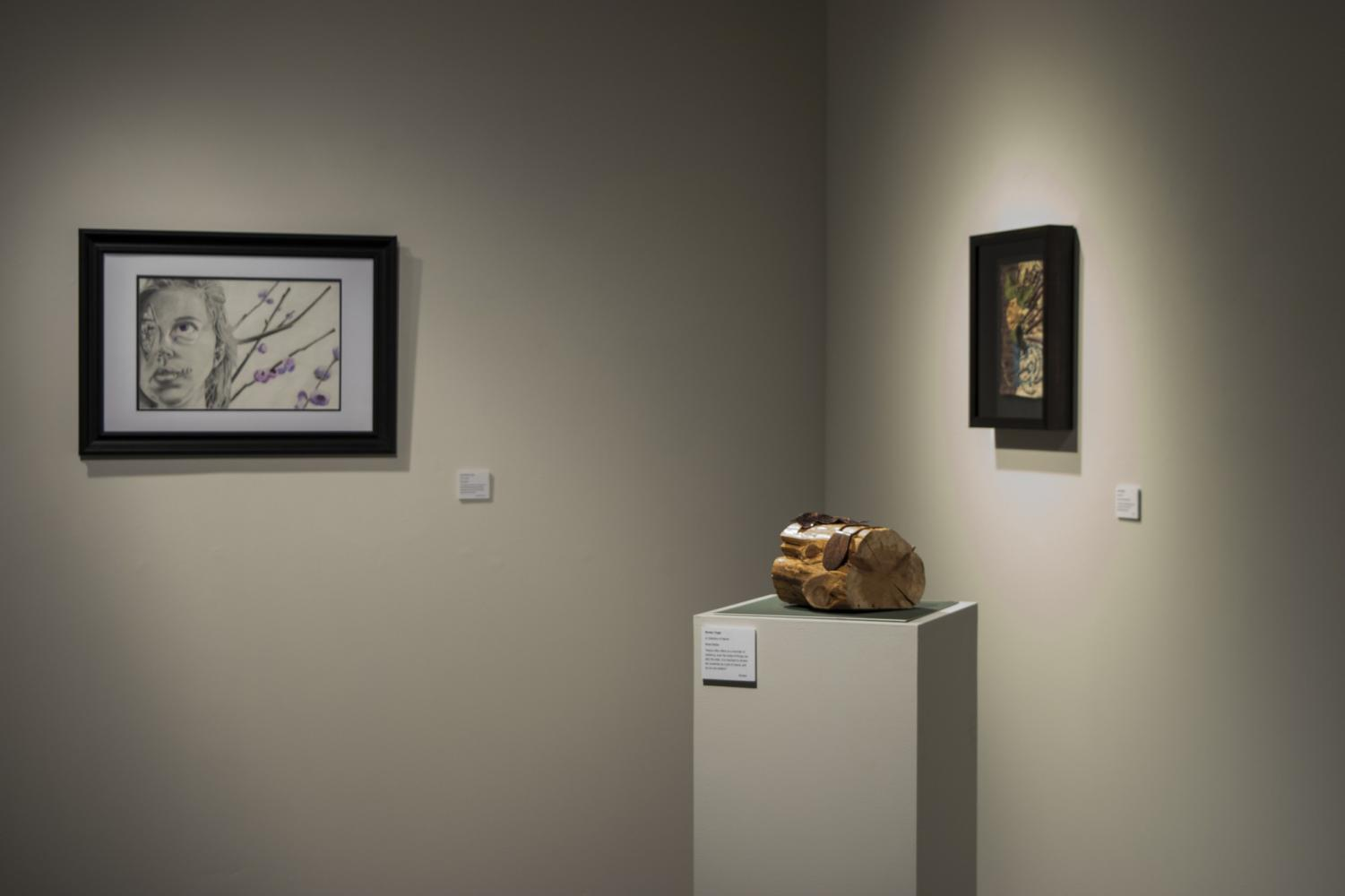 Art Therapy students display their work in the Suraci Gallery to demonstrate how art can help those suffering. Photo credit: Bethany Wade