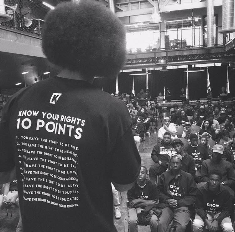 Kaepernick speaks to youth at one of his Know Your Rights Camp events.